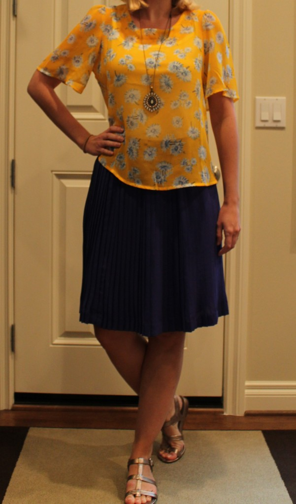 accordion skirt and yellow blouse