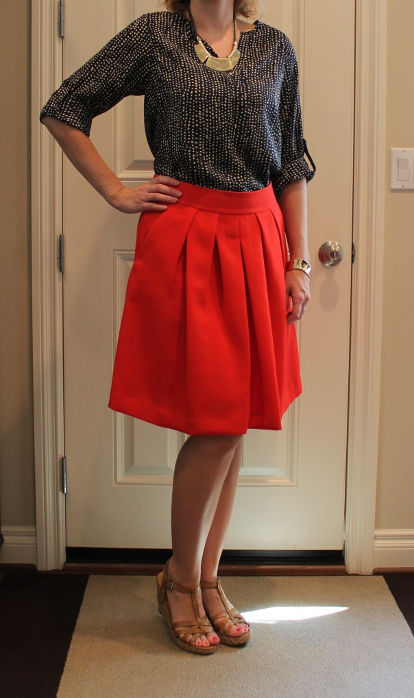 Dotted blouse and red skirt