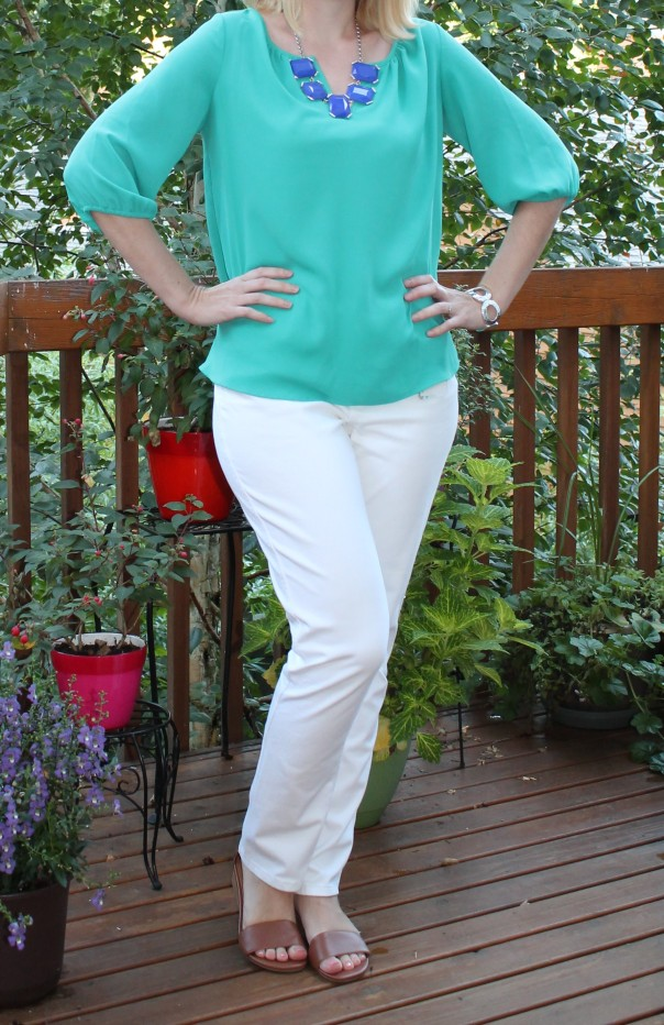 Teal blouse white jeans